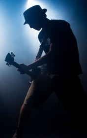 guitar player blue background