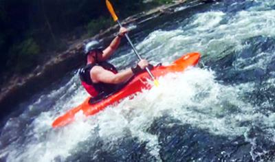 me whitewater kayaking...in the act of wrecking my wrist and getting tendonitis